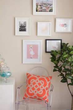 Pop of colour pillow, wall of illustrations and ghost chair