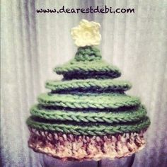 Crochet Christmas Tree HatCrochet Christmas Tree Hat is available in newborn and adult sizing. The newborn Crochet Christmas Tree Hat pattern is available HERE.I picked up some white Bernat dippity dots and while deciding on what to make a friend said a christmas tree. I decided to work up the newborn ...