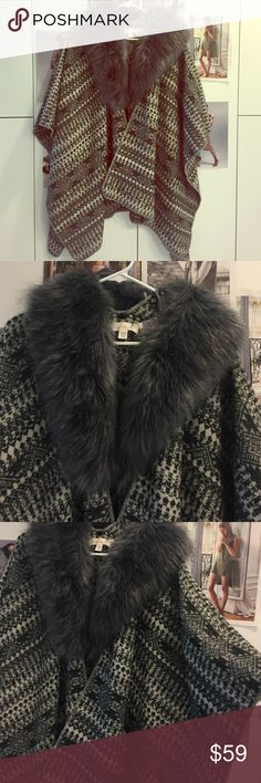 Fuzzy poncho 0/S Detachable fur. Super comfy and cute. Brand new with tags. Bundle and save on shipping/discounts. 🌷 It is a must have for fall/winter. boutique Sweaters Shrugs & Ponchos