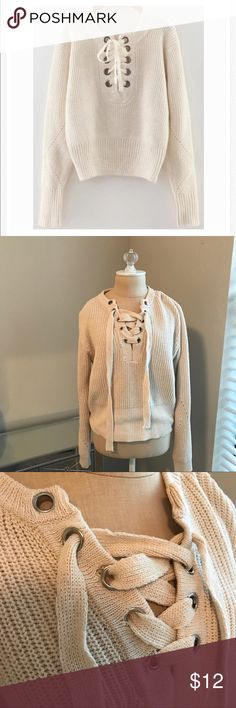 Lace Up Sweater Lace up sweater. One of the metal buttons is falling off, can probably be fixed though. Other than that good condition! Color is a cream/tan.                       •n o  t r a d e s• •s m o k e  f r e e / p e t  f r e e  h o m e•   •s a m e / n e x t  d a y  s h i p p i n g• Sweaters