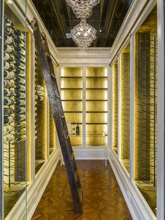 Custom Wine Room with Rolling Wood Ladder and Glass Door
