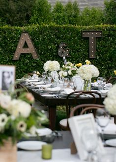 Set at a family home in Westlake Village California, this wedding is filled with rustic charm. There's nothing quite like the great outdoors, and this couple used Mother Nature's beauty to their full advantage. From a ceremony set amongst lush green trees to an open-air reception covered in white bl