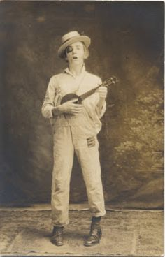 House of Mirth Photos & Ephemera - clown or hobo musician, patched overalls