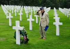 70th Anniversary of D-Day: PHOTO: 89-year-old World War II veteran Leslie Palmer Cruise Jr. salutes the gravesite of Pfc. Richard Vargas at Lorraine American Cemetery in St. Avold, France. Both Cruise and Vargas served as paratroopers with the 82nd Airborne on D-Day. See http://popularmilitary.com/photo-d-day-veteran-honors-the-fallen/