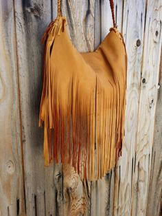 Check out this item in my Etsy shop https://www.etsy.com/listing/213046314/boho-fringed-distressed-deerskin-handbag