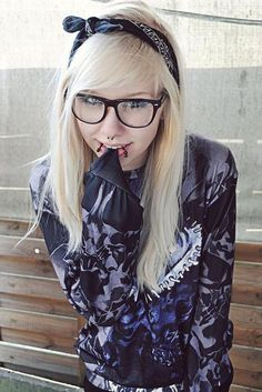 OMG! she is like an older me! I want snake bites and a septum. I have blonde hair and glasses like that :-D