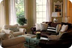 leather couches + white chairs- LOVE!