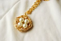 Items similar to Gold Toned Wire Wrapped Nest with Glass Pearl Eggs Necklace, made to order on Etsy Pearl Beads, Jewelry Shop, Wire Wrapping, Nest, Gold Necklace, White Gold, Eggs, Pearls, Chain