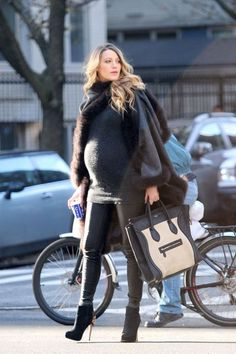 Blake Lively out in New York City wearing a Preserve cape Dec. 8, 2014.