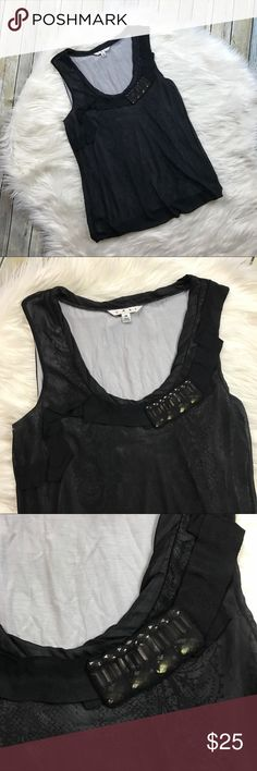 """CAbi Black Sleeveless Bubble Hem Layered Top Style #155. Such a cute tank! Double layer top with a sheer black top layer. The inside layer has a pattern underneath. Has a jeweled embellishment near the neckline. Gently used with no flaws. Self: 100% polyester. Contrast: 95% rayon, 5% spandex.  Measurements laying flat (without stretching)— Armpit to armpit: 19"""" Length, shoulder to hem: 26"""" CAbi Tops"""