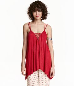 Check this out! H&M LOVES COACHELLA. Flared top in soft slub jersey with a sheen. Narrow, double shoulder straps and lace-trimmed V-neck with lacing. - Visit hm.com to see more.