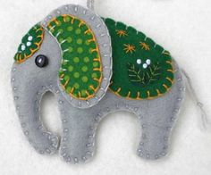 Handmade felt elephant ornament for Christmas or any occasion. Made from grey felt with hand-embroidered details in a range of colours. Please choose red, orange, green, teal, blue or purple from the Felt Christmas Decorations, Felt Christmas Ornaments, Handmade Christmas, Felt Crafts, Fabric Crafts, Sewing Crafts, Elephant Crafts, Felt Embroidery, Felt Brooch