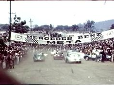 Santa Ana Road Races • El Salvador, April 1959 by Harlo. Fantastic vintage racing action shot by Dr. Carlos Alavarez and provided by George Kehler of the 1959 running of this marvelous El Salvador race. Set on the streets of Santa Ana, this race features Pedro Rodriguez in the #24 Austin-Healey 100M (he DNFed with ignition problems). Mauricio Miranda was the winner in the #42 Jaguar D-type with 2nd going to Manfredo Schmid in the Mercedes-Benz.