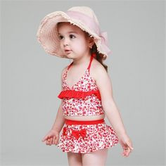Adorable flower print tankini set with cute red frills and bows is simply not to be missed this summer!