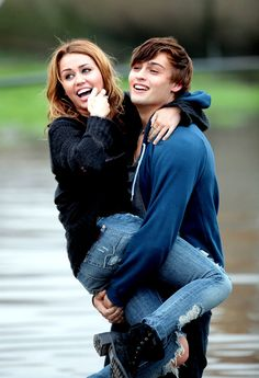 Miley with Douglas Booth filming a scene. Description from celebitchy.com. I searched for this on bing.com/images