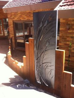 Cor 10 steel, plasma cut with grass design