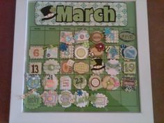 march calendar..metal base with scrapbook embellishments