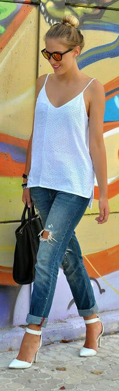 Gorgeous white blouse with denim stylish jeans and black leather cute hand bag and white high heels ladies nude pumps the best way to show fashion & style