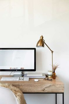 I love the warm tones of this office space. Gold and wood compliment each other so beautifully!