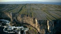 Rediscovering Ireland Inishmore, off Ireland's west coast, is one of the three Aran Islands, where most natives speak both Gaelic and Irish. In addition to the prevalence of Celtic culture, Inishmore is known for its grey limestone landscape, which ends in a rock wall at the sea's edge. (Sam Abell/National Geographic Stock)