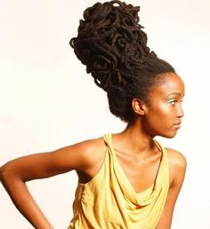 Free formed locs...beautiful. she has so much hair up there.  (ouch!)