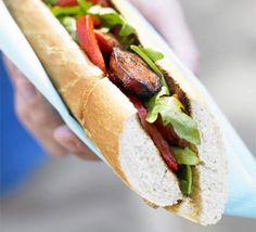 choripán -  is the ultimate Argentinean street food. Made with pork and beef chorizo cooked over charcoal or wood flames, the sausage is grilled then butterflied down the centre, topped with chimichurri, and served between slices of crusty bread.