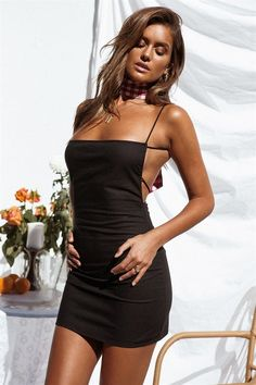 The on-trend Backless Jetta Dress is made from a lightweight, cotton blend fabric in black. It features an open back with ties, a square neckline and thin shoulder straps. Complete the look with strappy heels and minimal gold jewellery. By Sabo Skirt.