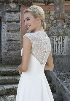 Beaded cap sleeves accent this sweetheart neckline Cinderella ball gown with a ruched chiffon bodice, natural waistline and beaded back.