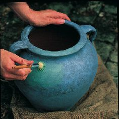 The attractive greenish coating that covers old, weathered copper is called verdigris. A typical verdigris kit contains several small pots of paint—one for each layer—and a stippling brush. It can be used to transform wood, metal, plastic or terra-cotta containers.
