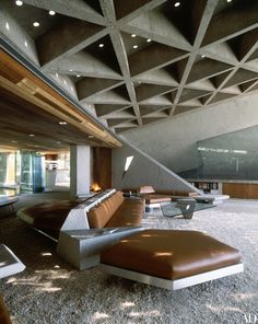 The angular theme of the house is echoed in the furniture, designed by Lautner, and the waffle gridded ceiling.