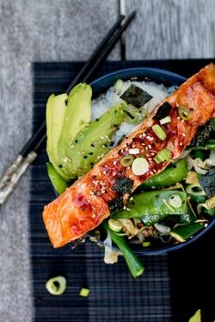Sticky, sweet teriyaki salmon bowls with sautéed sesame greens, sushi rice, avocado and toasted nori.