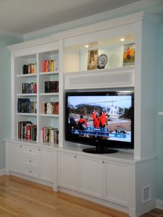 Something like this as the entertainment center in the living room. Bookshelf part would go up to just under that vent/line up with the rectangle part of those widows. We could then knickknack the crap out of the top of the bookshelves to add even more height. No more nakey wall!