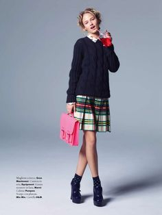 Layered cable knit sweater with pleated plaid skirt and socks with heels | For A Magazine Italy