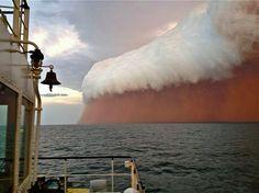 Onslow, Australia, - a dust storm  ahead of a cyclone approaches the western Australian coast.