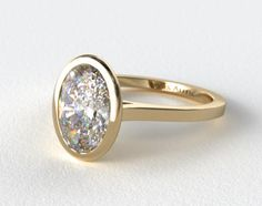 This simple yet elegant mounting has a thin, high-polished bezel surrounding the center diamond with a proportionate high-polished shank. Description from jamesallen.com. I searched for this on bing.com/images