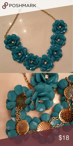 Large teal rosette necklace with crystal centers Chunky teal flowers with a crystal center make an amzing statement necklace.  Measures 25 inches long with al 4 inch extender chain for flexibility in length.  Each flower measures just over 2 inches across.  Excellent used condition. Jewelry Necklaces