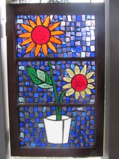 First mosaic using an old window....hangs winter/summer on back porch