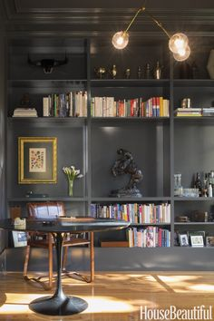 "Black built-ins are popping up everywhere lately, like in this study by Carmel Greer. ""This gray-black reminds me of shadows — for me, that's a good thing,"" she says. ""With the gold overhead light and leather chair, it's tailored and masculine, not cave-like.""Make it yours: Clark+Kensington Black Chiffon N-C15"