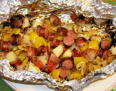Easy camping meal: italian sausage, potatoes, bell pepper and onion in a foil pack