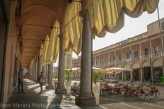 Faenza highlights: The porticoes of the historic district and promenade areas of Faenza in the Romagna region of Italy