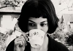 Anne Hathaway sipping her tea.