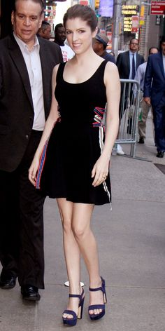 Anna Kendrick stepped out in New York City, wearing the chicest little black dress by Tanya Taylor. The flirty number featured a clean silhouette and colorful ribbon detailing on the sides. She kept the look simple and sweet with just a pair of chunky platform sandals.