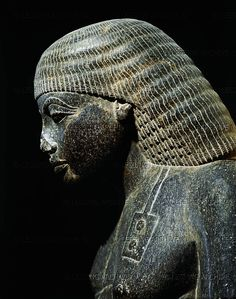 Egyptian sculpture, 15-13th BC bust of Amenhotep (1440-1360 BC), Son of Hapu, scribe and sage of the time of Amenhotep III (1411-1375 BCE). Black granite figure from Karnak, Egypt. New Kingdom (18th dynasty). Height: 130 cm See also 08-01-03/8 He was high official of the reign of Amenhotep III of Egypt, who was greatly honored by the king within his lifetime and was deified more than 1,000 years later during the Ptolemaic era.