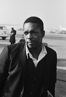 Photo of John Coltrane, 1963. From the Nationaal Archief [Dutch National Archives]. Used under Creative Commons License CC BY-SA 3.0 NL. John Coltrane was born in Hamlet, NC in 1926. Read more in NCpedia: http://ncpedia.org/biography/coltrane-john-william