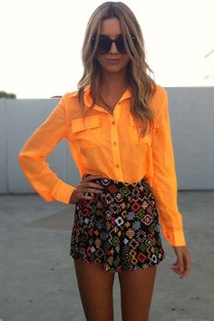 Love this entire ORANGE look. Pops of bright colour this summer can take your look from average to fabulous in seconds. Neon brights, bright blouses, printed short, shorts, color blocking.