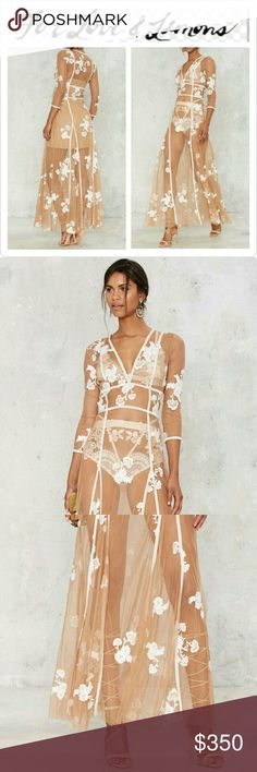 "HPFor Love & Lemons Elenora Maxi Dress NWT The Elenora Dress is made in nude mesh and features white velvet cage ribbon detail and white  floral embroidery throughout, plunging neckline, and sweeping maxi silhouette. Hidden side zipper Removable slip lining. Cage ribbon does not stretch and measures UNDER bust and at NATURAL waist 32"" Length is approx 43"" from natural waist. For Love&Lemons Size Gide Large: (6/8) BUST 38 WAIST 30 HIPS 40 No Trades ❔Ask Questions BEFORE You Buy  Thanks for…"