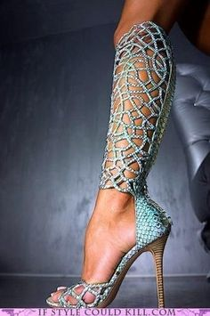 Really unusual shoes with designs up the leg in crystals!