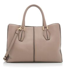 Artisan crafted in Italy, Tod's handbags are known around the world for their understated, sophisticated elegance. Contemporary and classic, they offer effortless, comfortable, and functional style. Tod's handbags have been spotted on celebrities such as Gwyneth Paltrow, Nicole Kidman and Jennifer Garner.