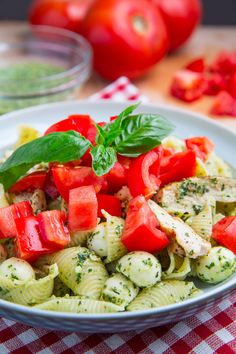Caprese Chicken Pesto Pasta. Super quick and easy pasta inspired by the caprese salad with fresh tomatoes, basil pesto and mozzarella along with some grilled chicken.