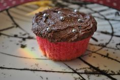 Pink cupcake with chocolatefrosting